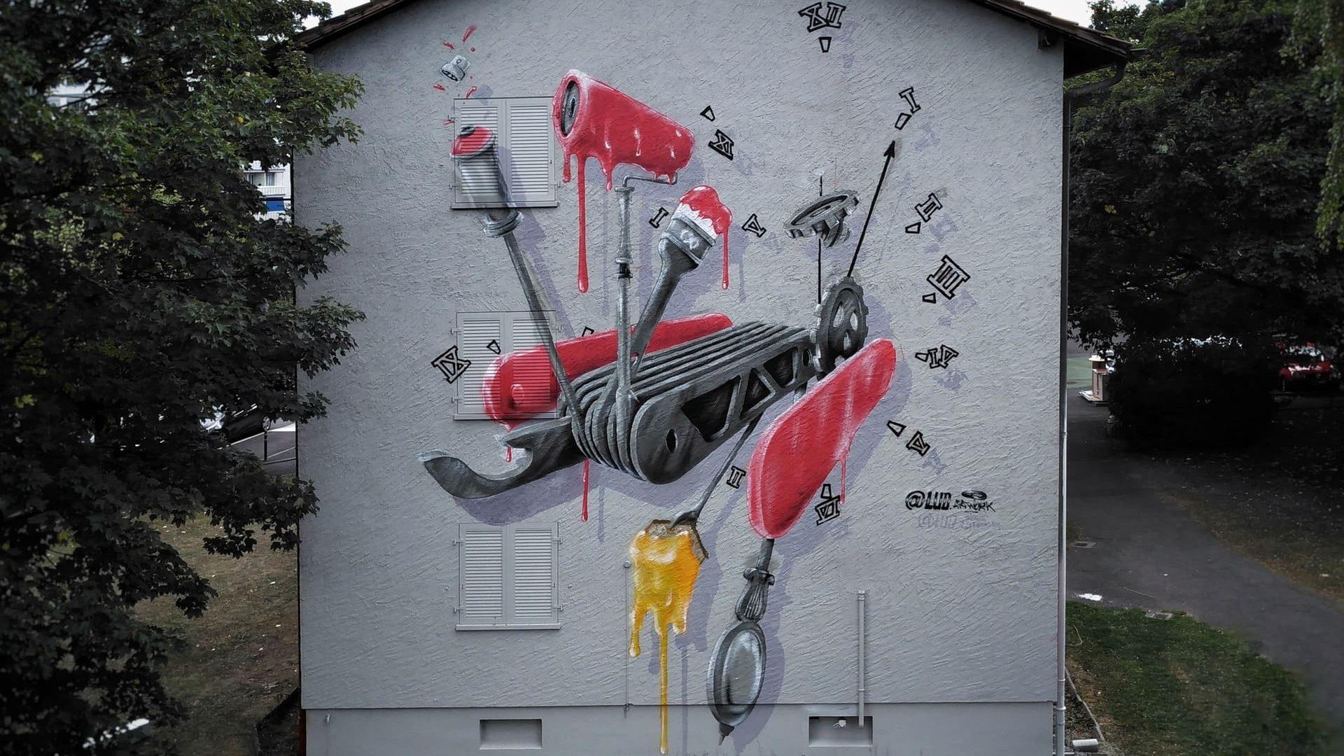 street art graffiti fresque graffiti murale couteau suisse rouge facade