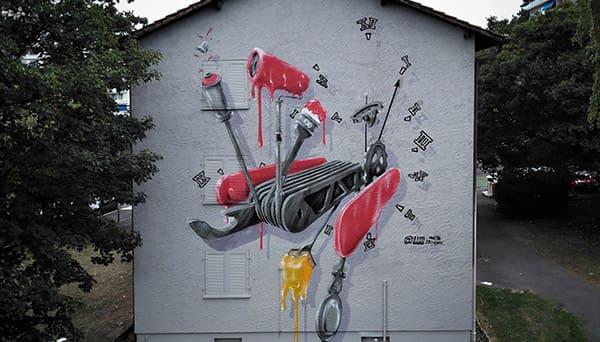 street art graffiti fresque murale couteau suisse rouge facade